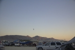 Someone parachuting at sunset