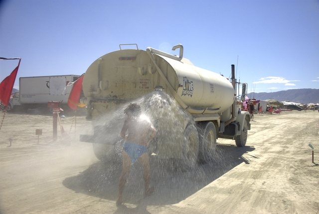 Water truck shower